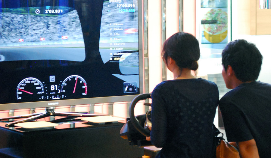 Woman playing game at arcade